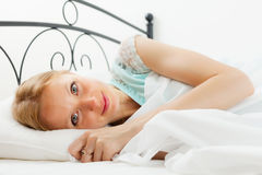 Pretty woman awaking in her bed Stock Photo