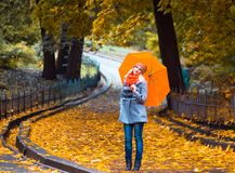 Pretty woman on backdrop of autumn leaves - seasonal relax concept.  Stock Image