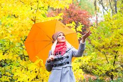 Pretty woman on backdrop of autumn leaves - seasonal relax concept.  Royalty Free Stock Image