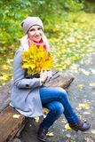 Pretty woman on backdrop of autumn leaves - seasonal relax concept.  Stock Photos