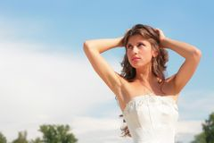 Pretty woman on background blue sky Royalty Free Stock Photography