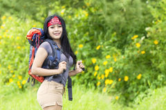Pretty woman with backpack in nature Stock Images