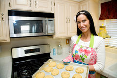 Pretty Woman Baking Cookies Royalty Free Stock Photo