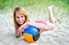 Pretty woman with the ball Royalty Free Stock Image