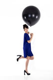 Pretty woman with balloon Stock Image