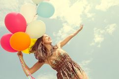Pretty woman with balloons Stock Photos
