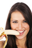 Pretty woman with banana isolated Royalty Free Stock Photography
