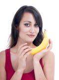 Pretty woman with banana Stock Photos
