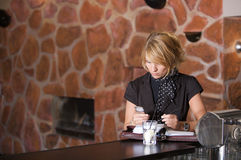 Pretty woman in the bar Royalty Free Stock Images