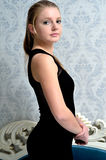 Pretty woman in the Baroque interior Royalty Free Stock Image