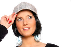 Pretty woman in a baseball cap Stock Images