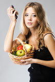 Pretty woman with a basket of fruit Royalty Free Stock Image