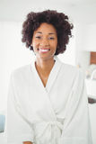 Pretty woman in bath robe smiling at the camera Stock Photography
