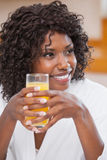 Pretty woman in bathrobe having juice Royalty Free Stock Images