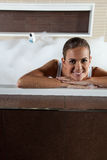 Pretty  woman in a bathroom Royalty Free Stock Image