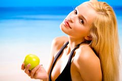 Pretty woman on the beach Stock Photography