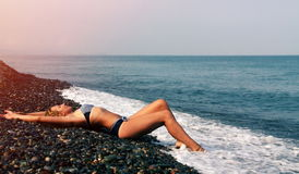 Pretty woman on beach Stock Photos