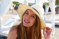 Pretty woman on the beach. Close up portrait of a nice girl with straw hat happy in her summer vacation enjoying resort on the. Beach stock photography