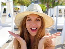 Pretty woman on the beach. Close up portrait of a nice girl with straw hat happy in her summer vacation enjoying resort on the. Beach royalty free stock image