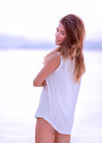 Pretty woman on the beach in the morning Stock Photography