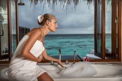 Pretty woman on beach resort royalty free stock photography