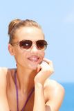 Pretty woman at the beach with sunglasses Royalty Free Stock Images