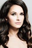 Pretty Woman. Beautiful Face. Curly Hair. Makeup Stock Photo