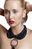 Pretty woman  and beautiful gold an silver jewelry Stock Images