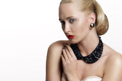 Pretty woman  and beautiful gold an silver jewelry Stock Photo