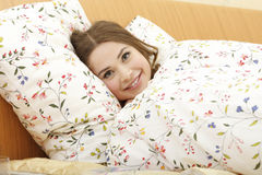 Pretty woman in bed Royalty Free Stock Photos