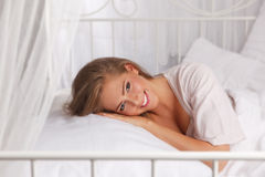 Pretty woman in the bed Stock Photos