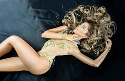 Pretty woman in the bed Royalty Free Stock Images