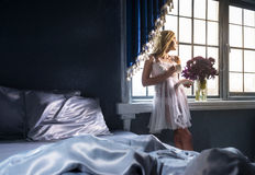 Pretty woman in the bedroom Stock Image