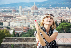 Pretty woman begging with her hands with the city of Florence be Royalty Free Stock Photo
