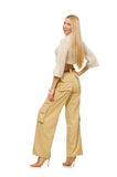 The pretty woman in beige trousers isolated on white Stock Images