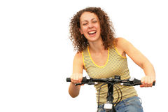 Pretty woman on a bicycle Royalty Free Stock Images