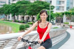 Pretty woman on bicycle Stock Image