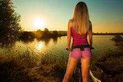 Pretty woman on bicycle relaxing at Sunset Royalty Free Stock Image