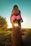 Pretty woman on bicycle relaxing at Sunset Royalty Free Stock Photo