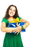 Pretty woman with a big present Stock Images