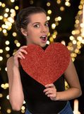 Pretty Woman with Big Red Heart Stock Photo