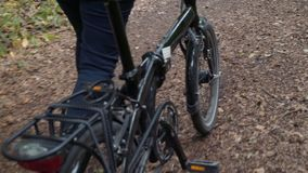 Pretty woman on a bike ride in the forest stock footage