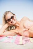 Pretty woman in bikini lying on the beach Royalty Free Stock Photos