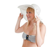 Pretty woman with bikini and sun ha. Beautiful young blond woman with bikini and sun hat royalty free stock photo
