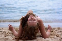 A pretty woman in bikini sunbathing at the beach Stock Photography
