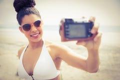 Pretty woman in bikini taking selfie Stock Image