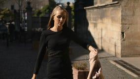 Pretty woman walks down the street