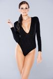 Pretty Woman in Black Long Sleeve Swimsuit Royalty Free Stock Photo