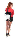 Pretty woman in black shorts posing with guitar Royalty Free Stock Photography