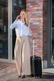 Pretty woman with black suitcase Stock Photos